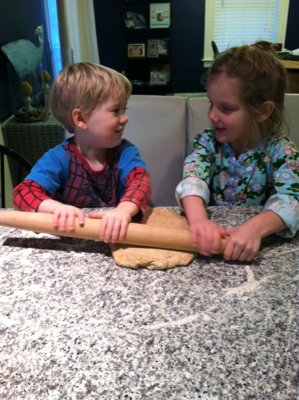 Liam and Maeve rolling out the homemade pizza dough.